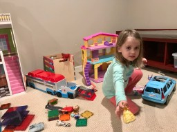 Little girl playing with princesses at Barbie house with mom via Ashley Stevens at Mountains Unmoved