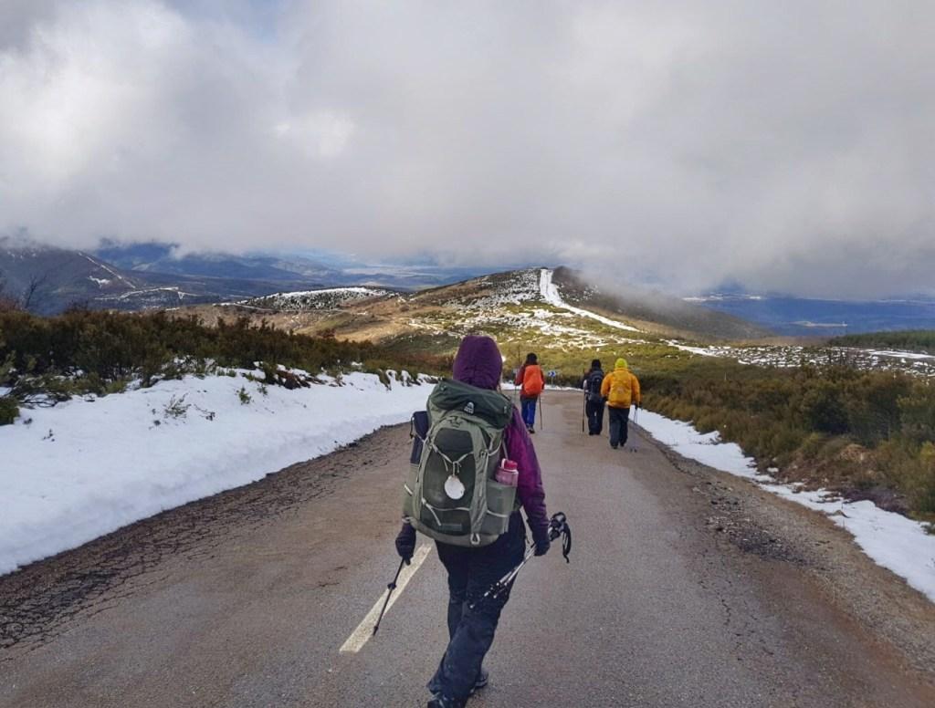 Winter camino de santiago pilgrims hiking down the road
