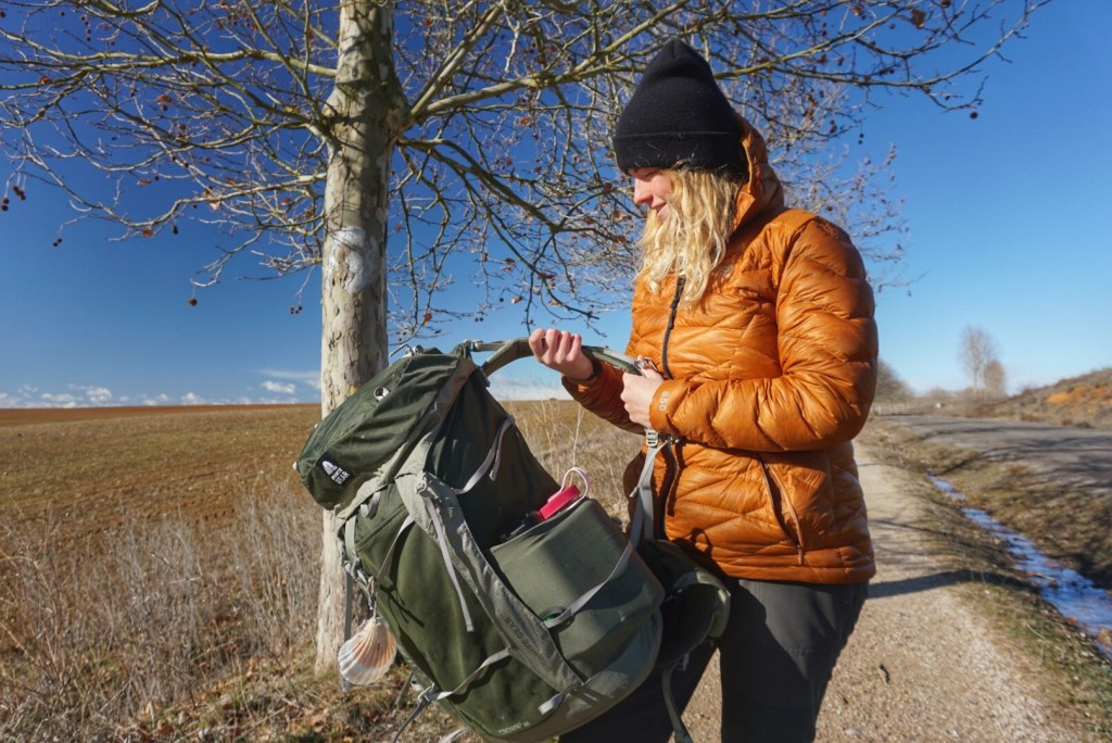 A hiker picks up her Granite Gear backpack along the Camino de Santiago.