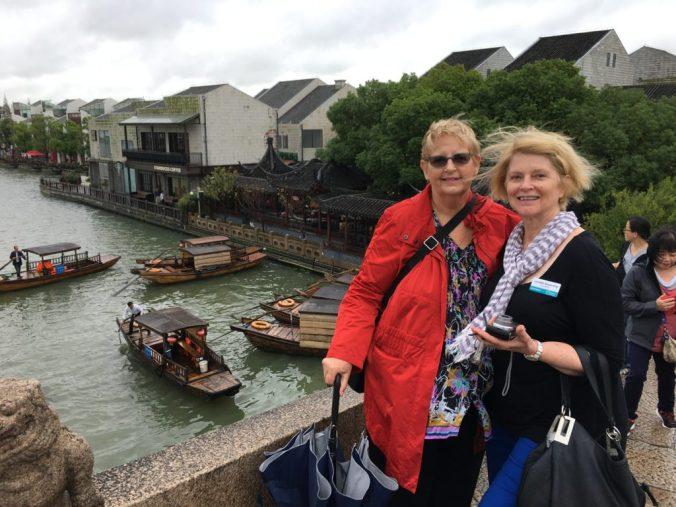 Joan & Lyn on a blustery day in Zu Zha Zhou