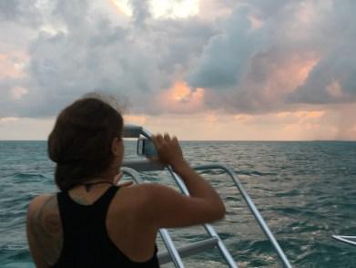 Christina Capturing the sunset in San Pedro Belize