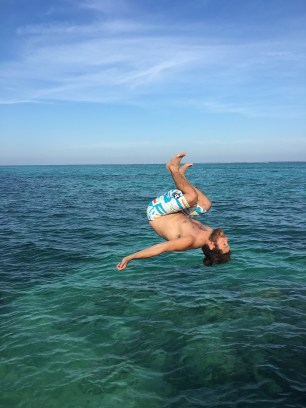 Rocky flipping into the Caribbean Sea, Ambergris Caye, Belize