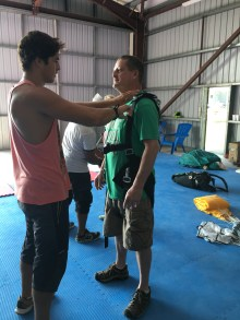 Max gearing up Abby's dad for a skydive