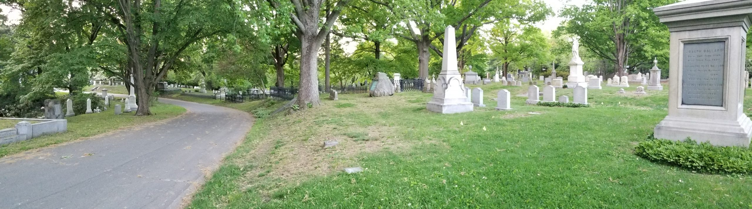 Historic landscape with historic monuments and mature canopy trees.