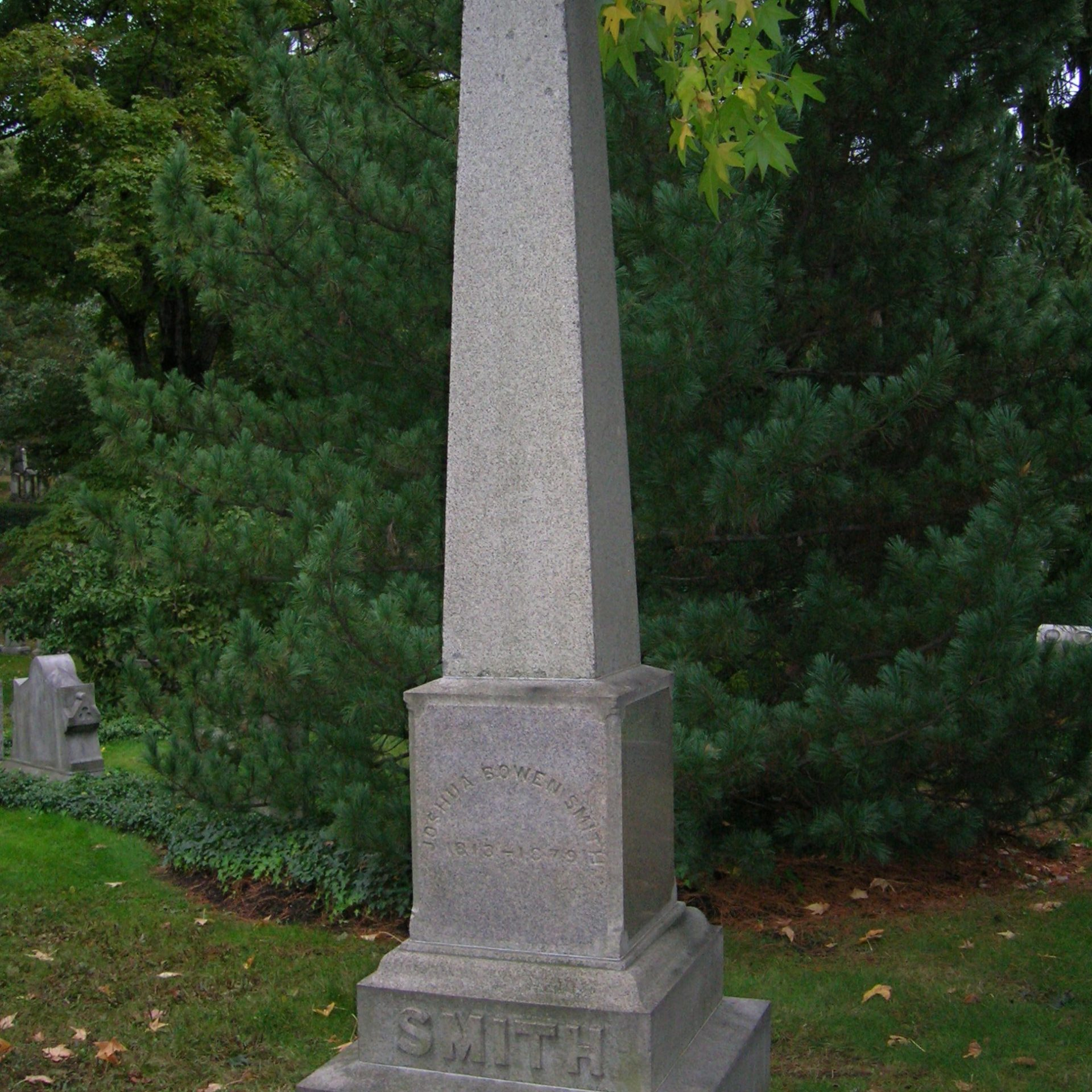 Simple obelisk made of granite. There is some staining, but inscription remains completely legible.