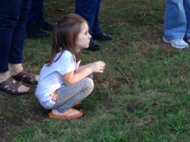 A young visitor watches a performance at Tales of the Crypt 2013