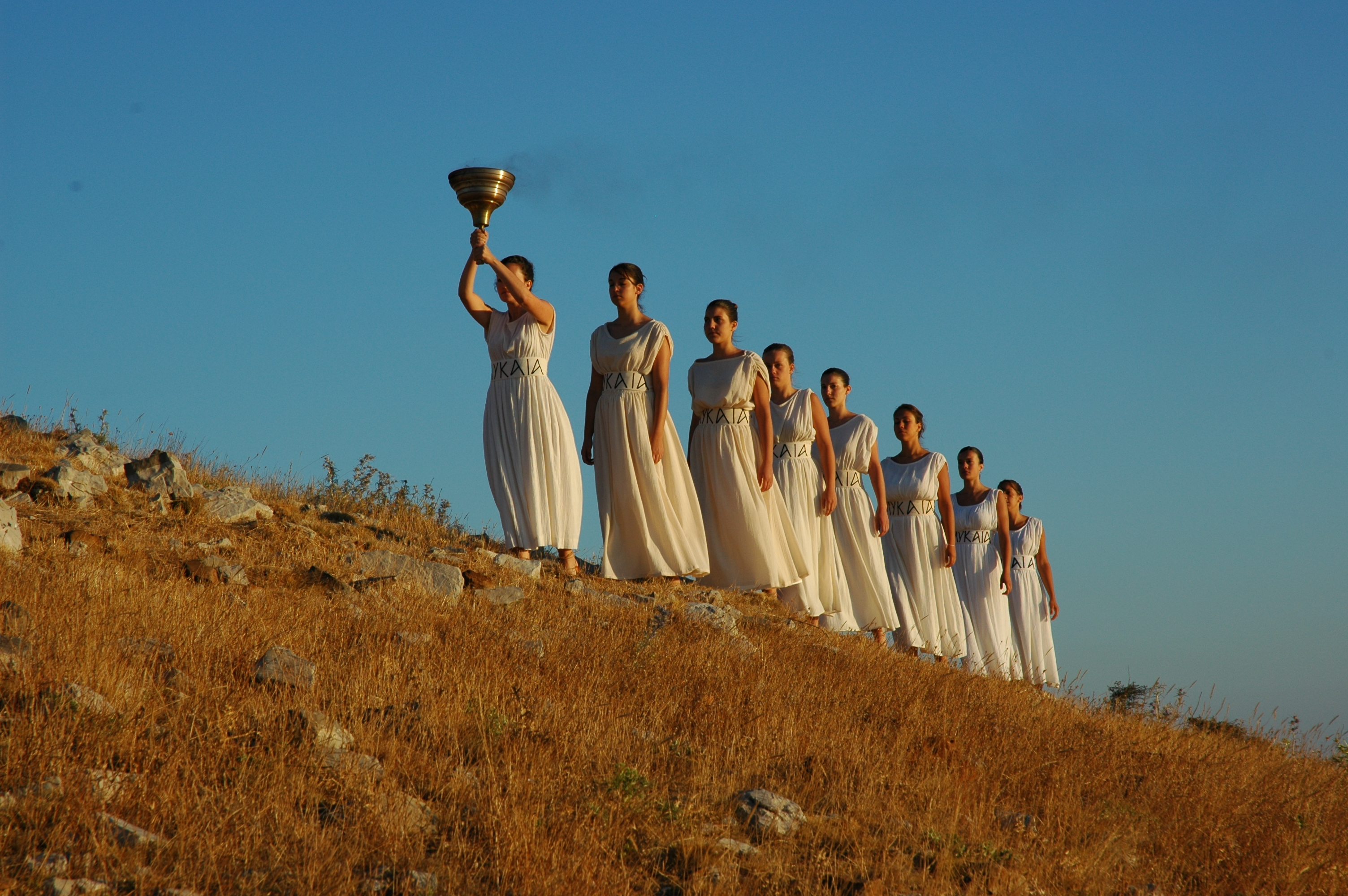 Modern Priestesses bringing the flame to the Temenos of Zeus