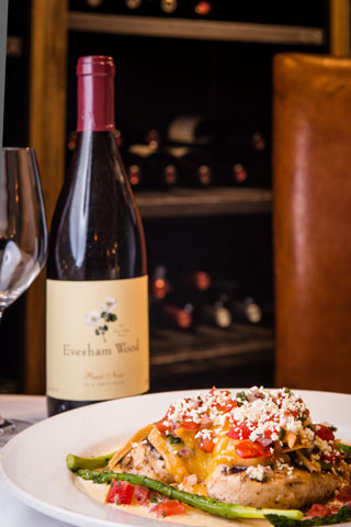 Wood grilled chicken with Mexican cheese, avocado, garlic cream and crisp tortillas served with Evesham Wood Pinot Noir, available only at Red Drum in Mount Pleasant.