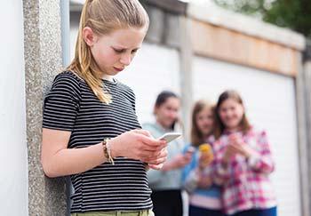 teen girls making fun of one of their peers