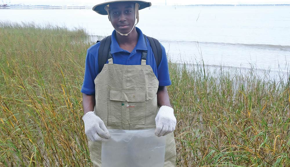 Burke H.S. student participates in the oyster bed restoration project