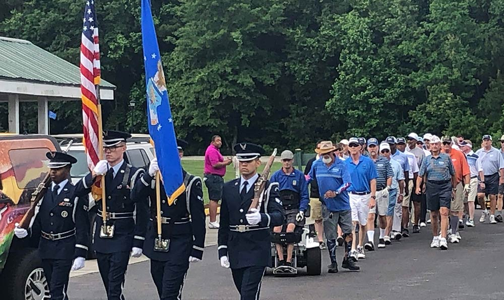 PGA HOPE veterans passing in review at The Golf Club at Wescott Plantation.