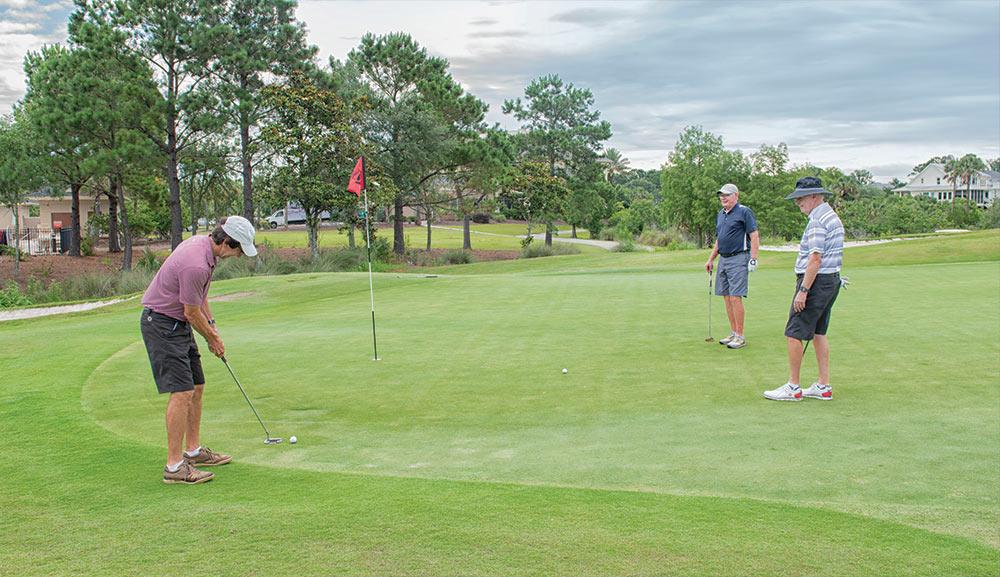 3 golfers on the green during the coronavirus pandemic.