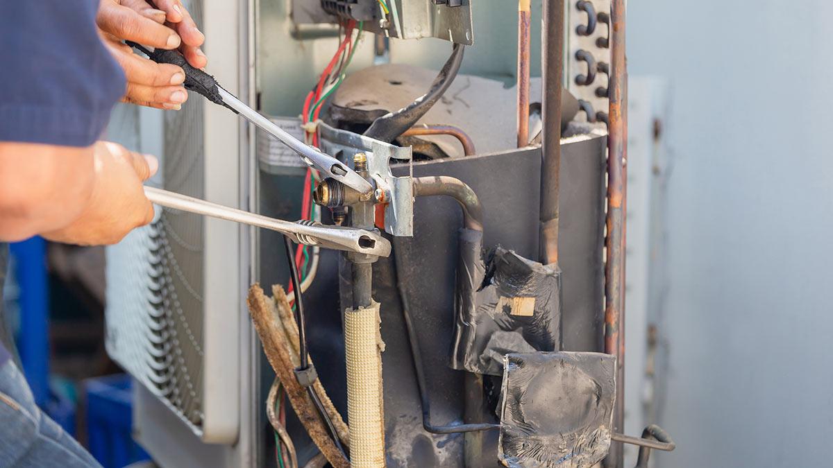Technician working on an HVAC unit