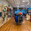 Photo inside of the Holy City Tennis Shop showing lots of great gear