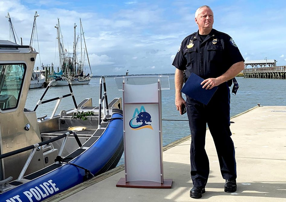 Mount Pleasant, SC Police Chief Ritchie stands next to a new Mount Pleasant PD boat