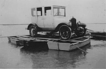 Hecker devised a floating pontoon of three row boats tied together, then balanced his Model T on top and drifted it over to Morris Island. Photo courtesy of Save the Light, Inc.