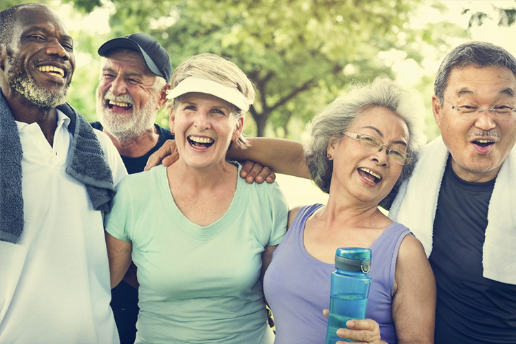 Senior Living lifestyle photo: happy seniors relax after exercising.