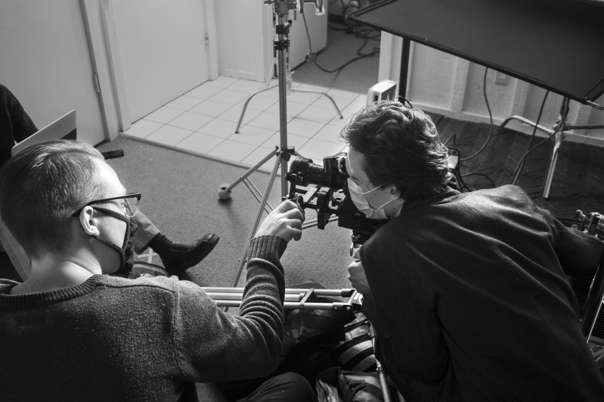 1st AC Beck Potucek and writer-director William Jacobs filming a shot.