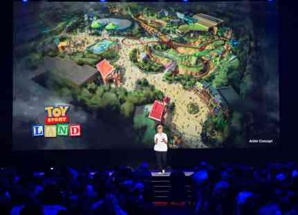 Aug 16, 2015. Imagineer Kathy Mangum showing Toy Story Land concept art at D23. Copyright 2015 The Walt Disney Company.