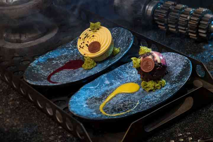 Raspberry Crème Puff and Chocolate Cake ©Disney Parks