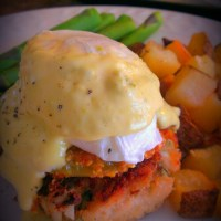 Blue Crab Cake Eggs Benedict with Fried Green Tomato and Jalapeno Hollandaise