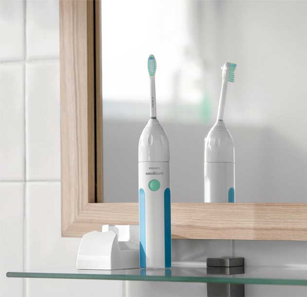 Philips Essence toothbrush sitting on bathroom shelf