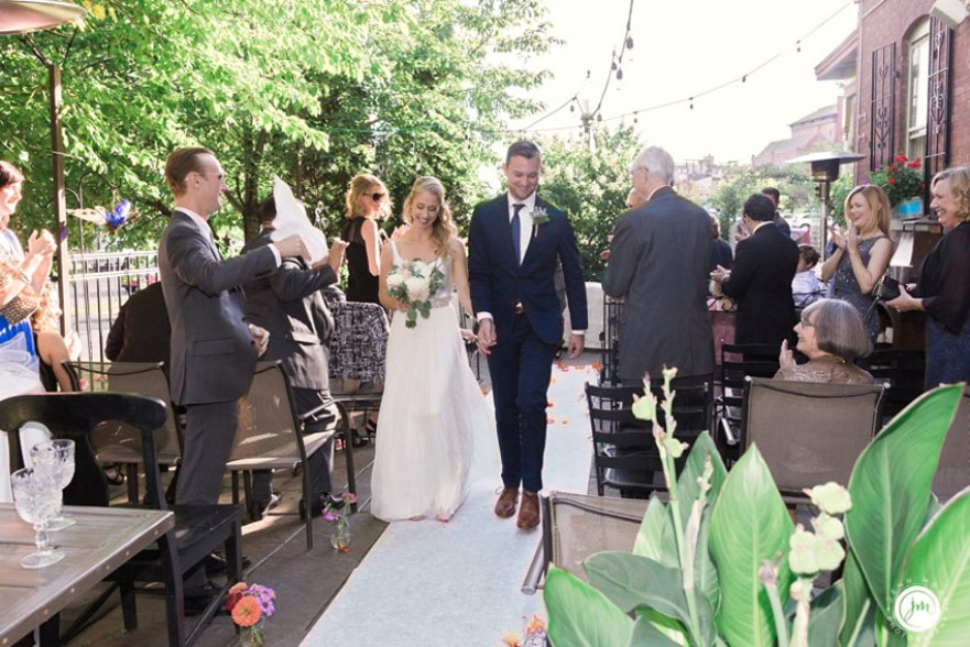 Michelle and David getting married on the High Rock patio at The Mouzon House in Saratoga Springs, 2016. Jenn Moak photo