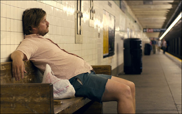 """Tim Heidecker sits in a subway station in a scene from Rick Alverson's """"The Comedy"""""""