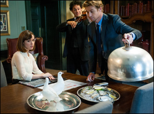 Rose Byrne contends with doves presented by Simon Baker in a scene from I Give It A Year