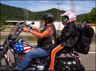 """Ron Hall and wife Alicia on a motorcycle in Debra Granik's """"Stray Dog"""""""