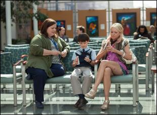 """Melissa McCarthy, Jaeden Lieberher and Naomi Watts in """"St. Vincent"""""""