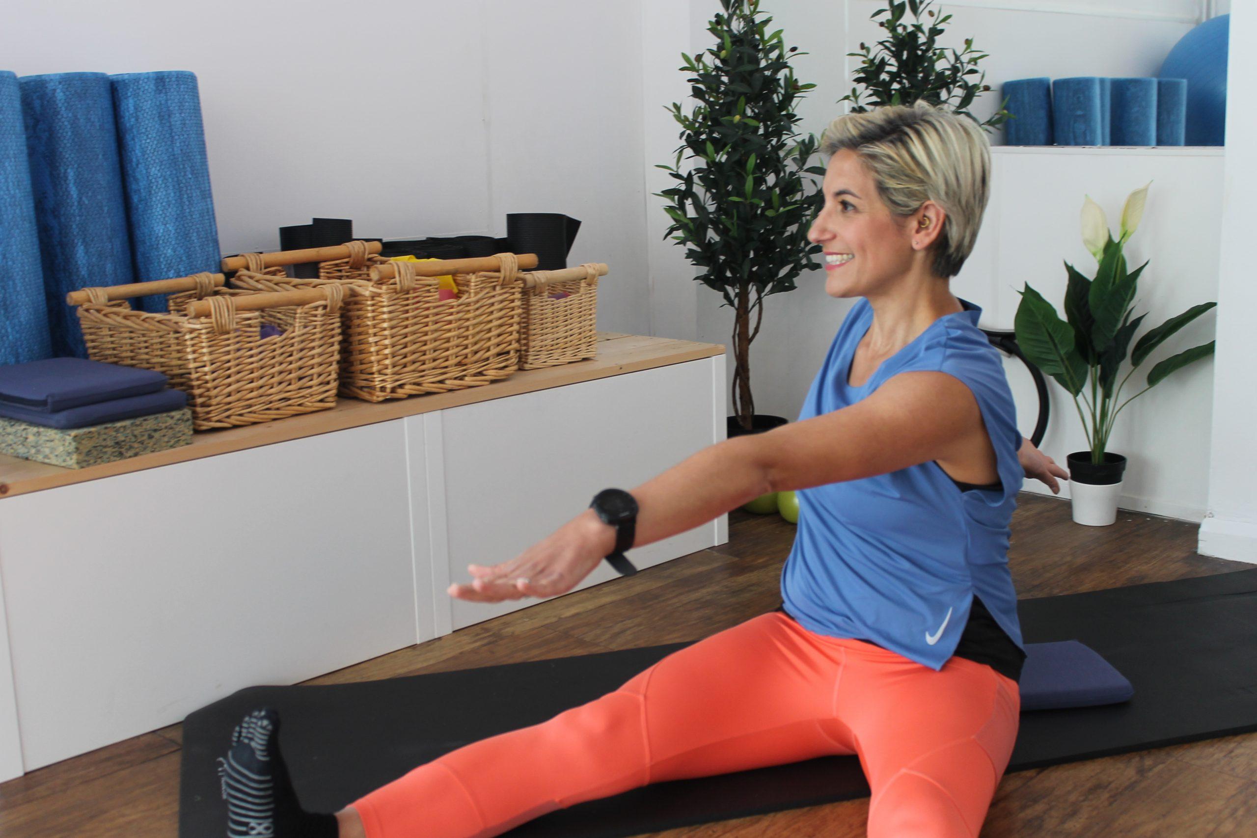 Pilates instructor Anna doing pilates move