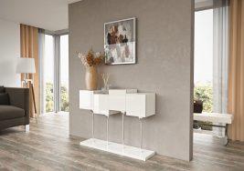 Consola em lacado alto brilho branco com pés em inox. Peças de mobiliário que transformam os ambientes.