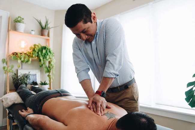 Manual therapy on upper back with physical therapy