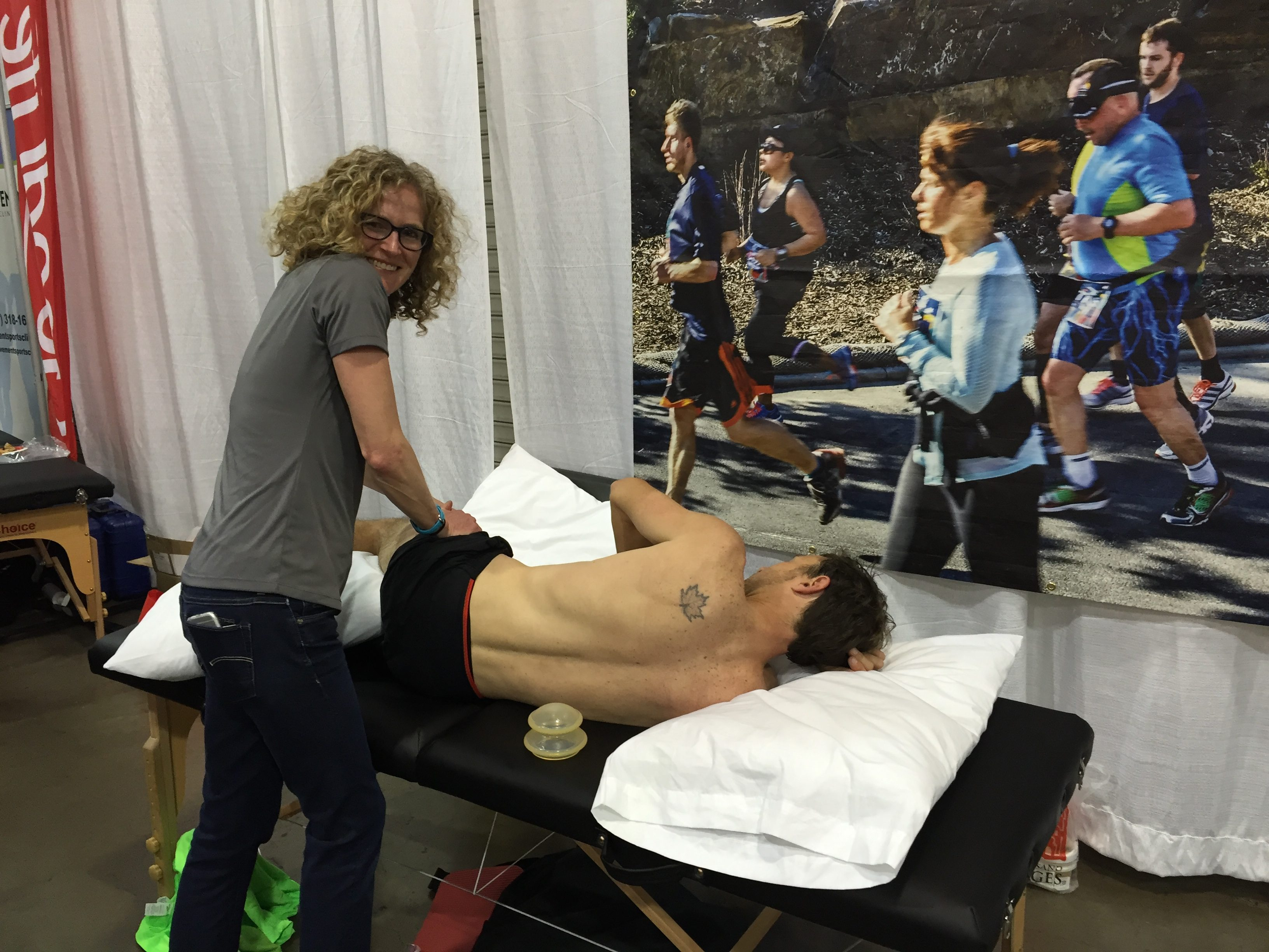Louise Taylor providing manual therapy during the event