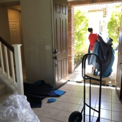Picture of Movers and Movers uses moving blankets to cover the furniture