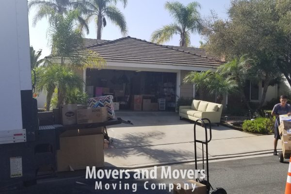 Picture of Movers and Movers taking out stuff from garage into the truck