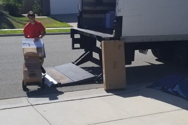 Picture of how Movers and Movers using liftgate and stocking the truck