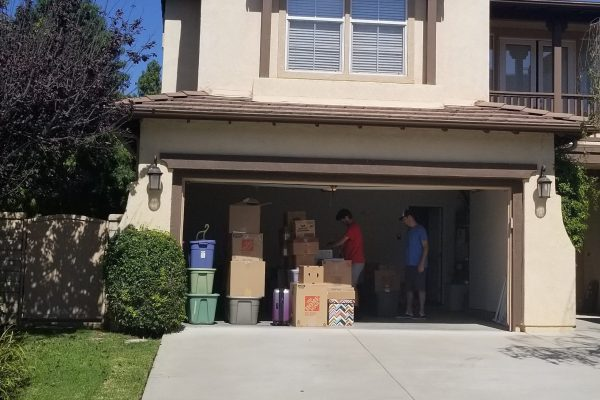 Picture of how Movers and Movers unloading the boxes into customer's new garage