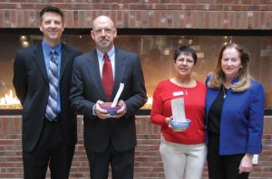 Kevin Cedik, general manager of Liberty Center; Stephen P. Noe, president of the Faith Alliance; Lourdes A. Ward, CEO/executive director of Reach Out Lakota; and Lynda O'Connor, president of C3