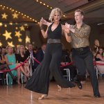 Dance champions Leigh Bradshaw and Jay Lame, wearing gold lame