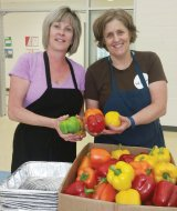 Volunteer cooking instructor Laurie Schrand, a registered dietitian, and La Soupe chef Suzy DeYoung.
