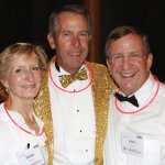 Emcee Mike Brown (center) with event chair Susie Lame and John Lame