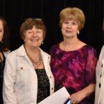 Jackie Lang, MWC president; Ann Daumeyer, recording secretary; Joyce Yock, fashion show chair; and Diana Davis