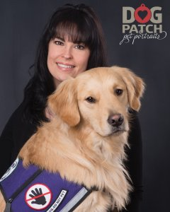 Circle Tail board president Jen Kiblinger and River, a golden retriever she helped train and foster