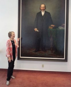 Judy Lucas with the life-size portrait of Rabbi Isaac Mayer Wise