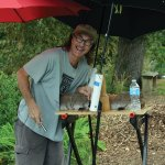 Woodcarver Keith Howard uses umbrellas to shelter his work.