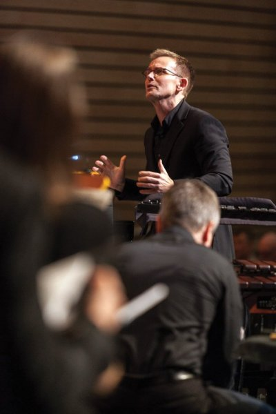 "Craig Hella Johnson leading Conspirare in a 2016 performance of his ""Considering Matthew Shepard."" Johnson will conduct the work with Cincinnati's Vocal Arts Ensemble. (Photo by James Goulden for Conspiraire)"