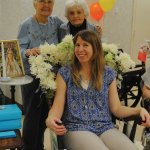 Staff member Tori Kadish (rocking) with residents Nancy Jung and Kitty Stickley