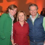 Volunteers April Kerley and Kelly Camm with Kevin Jones, president of Huntington Bank's Southern Ohio-Kentucky Region